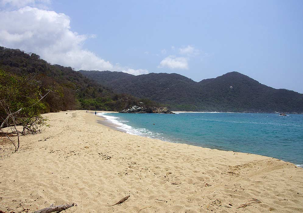 Beautiful barren beach of Tayrona with blue sky and water