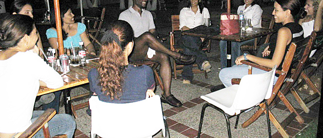 Black Man meeting many Colombian women with only one chair vacant