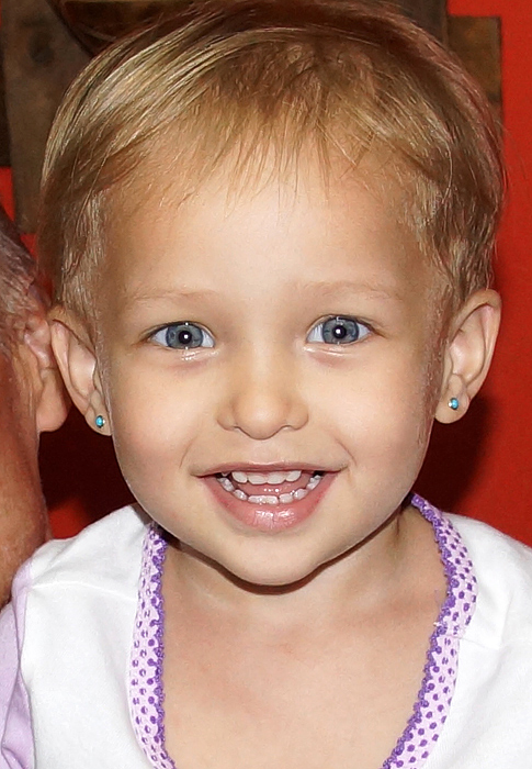 Blond hair and blue eyes and all smiles