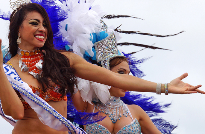 Exotic Buxom women in carnival costumes