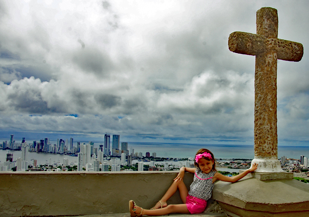 Five year old child next to a cross overlooking Bocagrande Cartagena