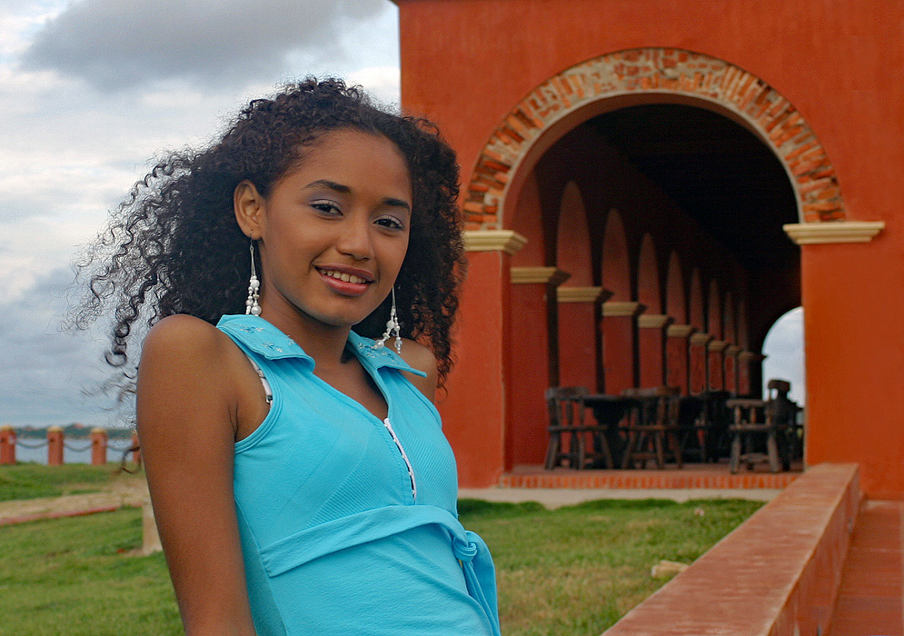 Caribbean woman on the coast at the Castle of Salgar in Colombia