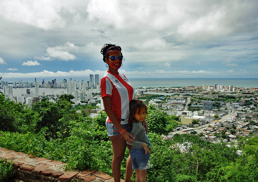 A Colombian mom and her daughter on a hill-top overlooking Cartagena
