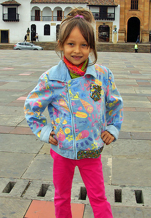 Little girl wearing bright colors on a cool day