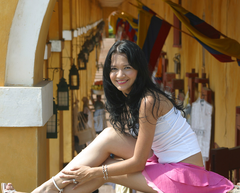 An exotic Colombian woman in the colorful marketplace of Cartagena