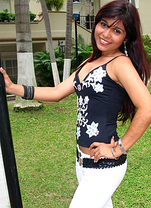 A beautiful Hispanic wife posing around palm trees