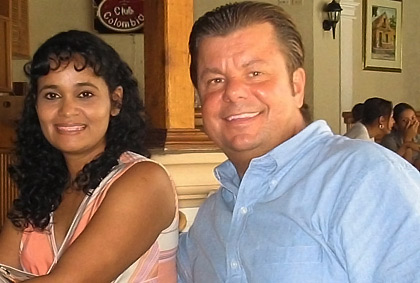 American man and Colombian woman smiling together