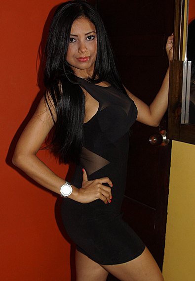 Beautiful Latina with long black hair dressed in a black dress