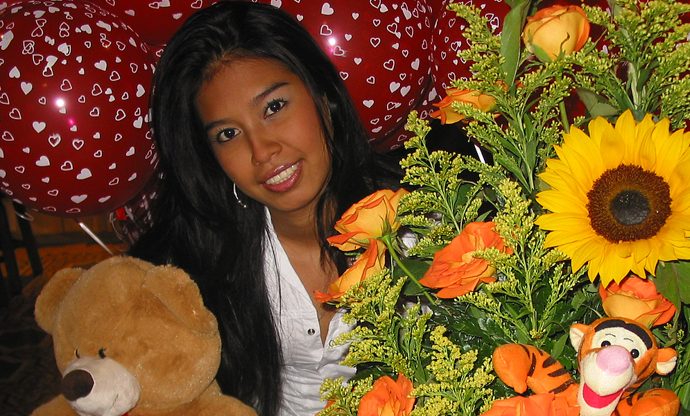 Colombian wife reciving gifts of flowers, ballons and cake