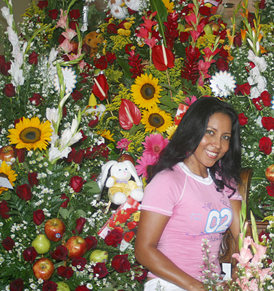 Loyal Colombian woman surrounded by flowers