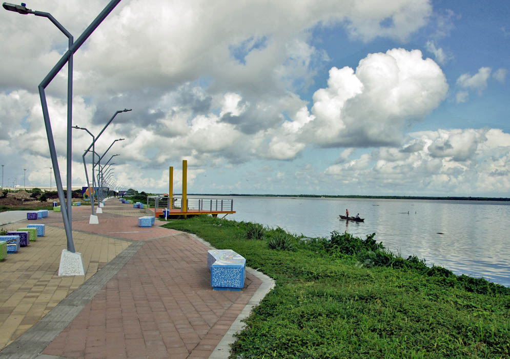 A walkway parallel to the Magdalena River and a lone fishing boat