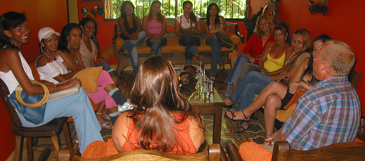 One man interacting with 12 Colombian women during a private romance tour