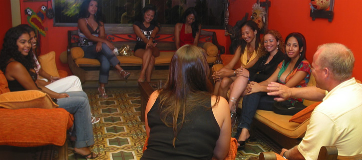 One man conversing with 12 Colombian women during a private romance tour
