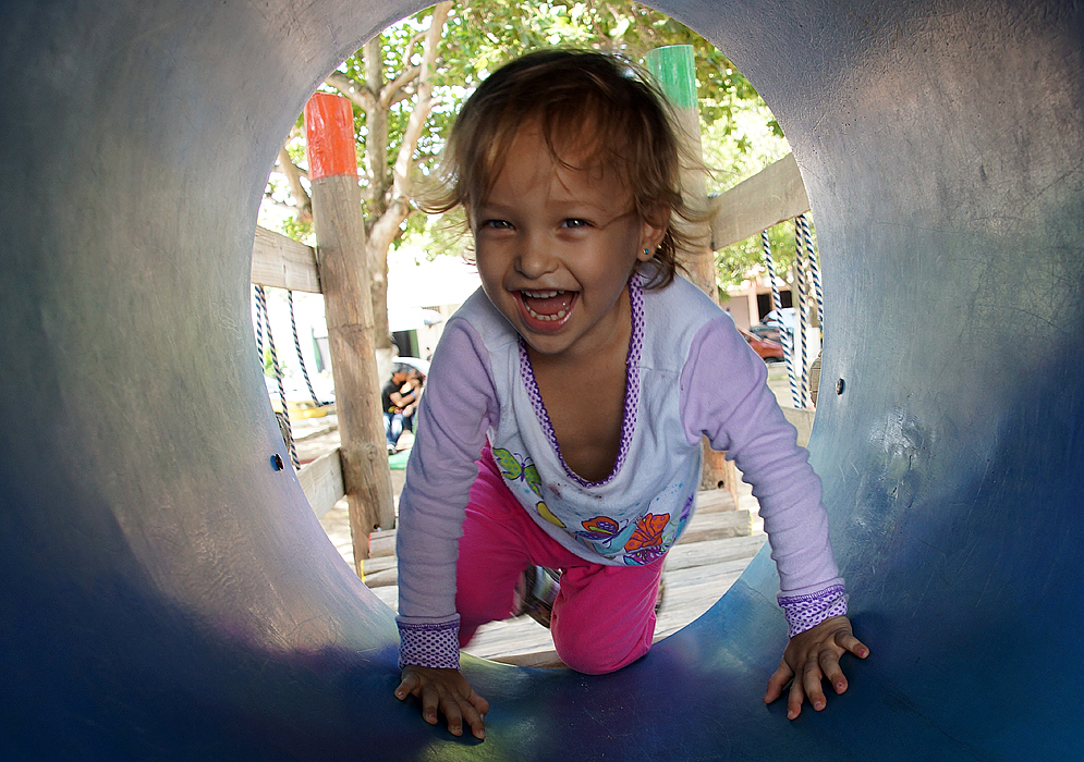 A laughing child playing in the playground