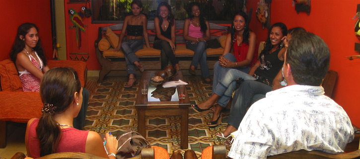 One man being introduced to a small group of lovely Latin women in a private setting