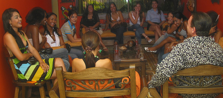 One man being introduced to a small group of pretty Colombian women