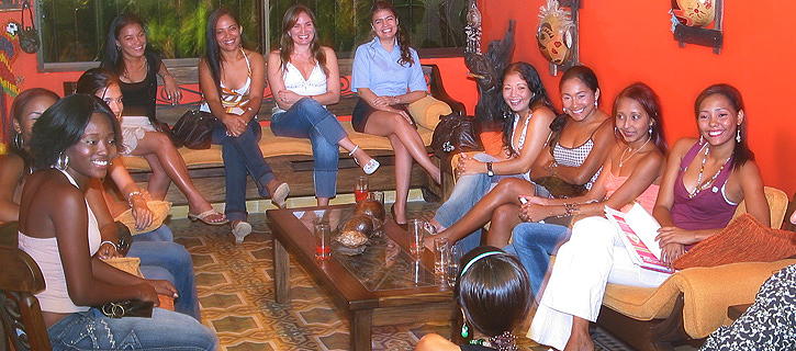 One man being introduced to a small group of attractive Hispanic women