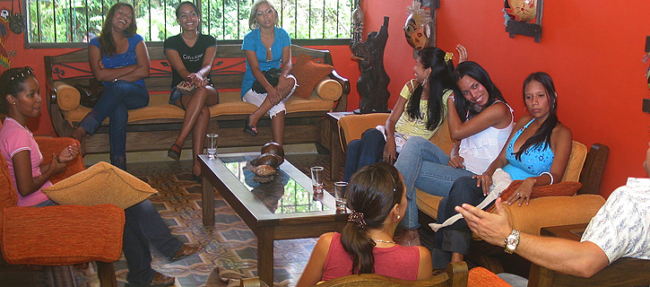 One man being introduced to a small group of attentive Latin American women