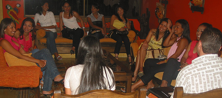 One man being introduced to a small group of happy Latin women