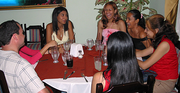 A small group of Latin women meeting one man during a romance tour