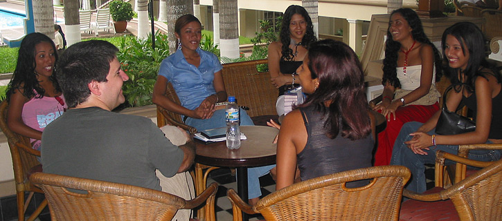 A small group of Latin women meeting one man during a romance tour at a restaurant