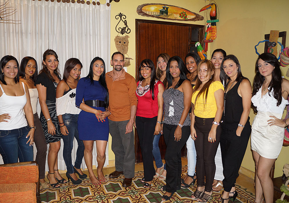 One man in the center of 13 gorgeous Colombian woman after a Romance Tour introduction
