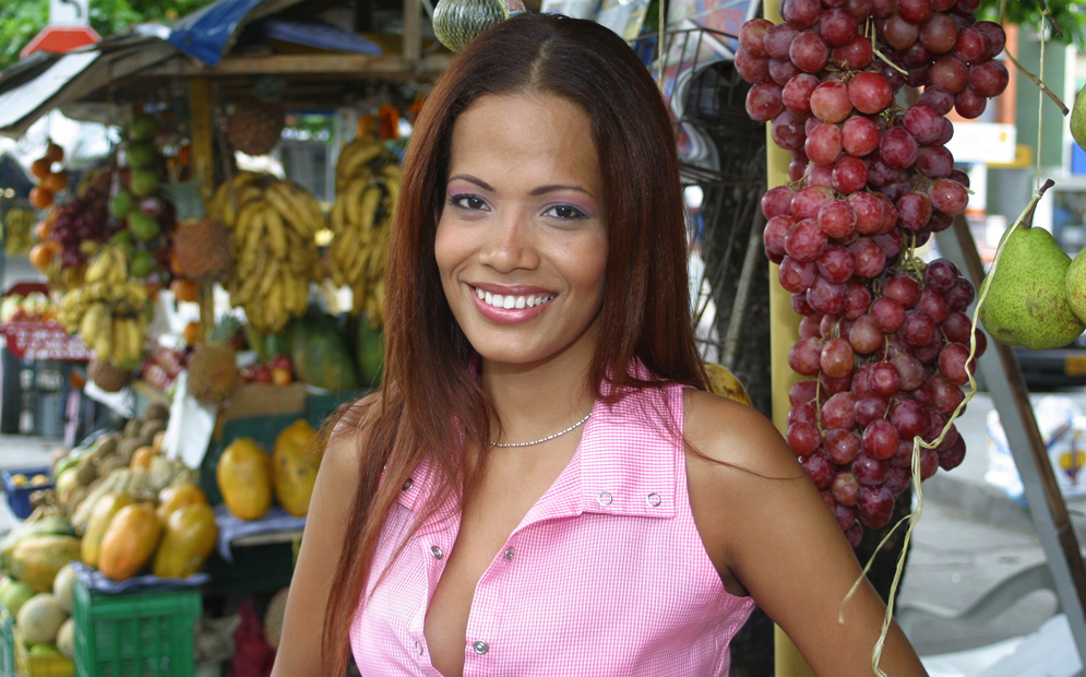 A Caribbean woman in a tropical fruit market