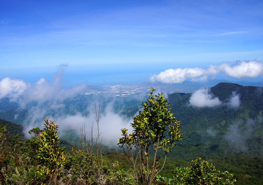 Vista of Santa Marta from Kennedy mountain on a clear day with white clouds forming